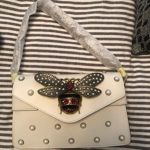 100% authentic butterfly pearl creme Gucci bag